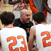 HADLEY GREEN/Staff photo<br /> Beverly Coach Matt Karakoudas talks to his team during a timeout at the Beverly v. Lynn Classical boys basketball game at Beverly High School.<br /> <br /> 1/09/17