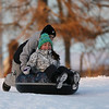HADLEY GREEN/Staff photo<br /> James Silva pushes his sister Joselyn down the hill at Lynch Park in Beverly on Saturday.<br /> <br /> 1/06/17