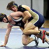 HADLEY GREEN/Staff photo<br /> St. John's Prep's Tim Galvin wrestles Malden Catholic's Kevin Batting at the St. John's Prep v. Malden Catholic wrestling match at St. John's Prep.<br /> <br /> 1/10/17