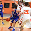 HADLEY GREEN/Staff photo<br /> Danvers' Justin DiTomaso (12) dribbles past Beverly defenders at the Beverly v. Danvers boys basketball game at Beverly High School.<br /> <br /> 01/05/17