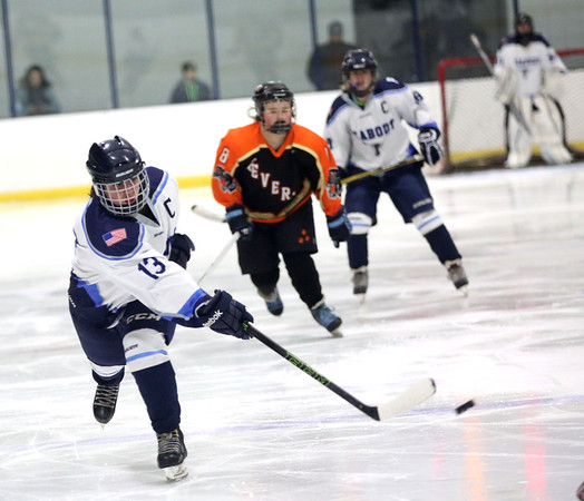 HADLEY GREEN/Staff photo<br /> Peabody's Cassie Mirasolo (13) shoots at the Peabody v. Beverly girls hockey game at the McVann-O'Keefe Rink in Peabody. <br /> <br /> 01/17/18