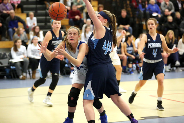 HADLEY GREEN/Staff photo<br /> Danvers' Sarah Unczur (15) and Peabody's Jonalyn Carpenter (44) vie for the ball at the Danvers v. Peabody girls basketball game at Danvers High School. <br /> <br /> 01/03/17