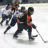 HADLEY GREEN/Staff photo<br /> Beverly's Jessica Adkerson (16) moves the puck towards the net at the Peabody v. Beverly girls hockey game at the McVann-O'Keefe Rink in Peabody. <br /> <br /> 01/17/18