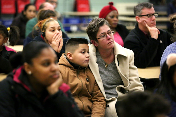 HADLEY GREEN/Staff photo<br /> Michelle Rosa and her son Matthew, 10, a Nathaniel Bowditch School student, listen to Salem School Superintendent Margarita Ruiz speak about the school's closure. Ruiz announced to students, families and community members that the school will be dissolved after this year and students will be absorbed into other Salem public schools. <br /> <br /> 01/24/18