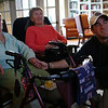 HADLEY GREEN/Staff photo<br /> Longtime Danvers resident Ellie Ross celebrates with friends and family at Brookdale in Danvers after returning from a ski trip in Colorado. Ellie was able to ski one last time in an adaptive ski program run by an organization called Wish of a Lifetime. Ellie holds hands with her grandson, Jacob Beaubier, while watching a video of her trip. <br /> <br /> 01/24/18