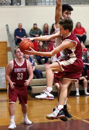 HADLEY GREEN/Staff photo<br /> Newburyport's Jacob Robertson (13) tries to make a pass while Masconomet's Nick Mangino (32) blocks him at the Masconomet v. Newburyport boys basketball game.<br /> <br /> 1/12/17