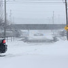 HADLEY GREEN/Staff photo<br /> Police cars block off the intersection of Federal Street and Park Street in Beverly due to flooding during Thursday's blizzard.<br /> <br /> 01/04/17
