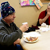 HADLEY GREEN/Staff photo<br /> Tony Romano, left, and Jim Ellsworth, right, enjoy lunch at Lifebridge shelter in Salem during Thursday's blizzard.<br /> <br /> 01/04/17