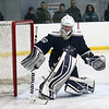 HADLEY GREEN/Staff photo<br /> Hamilton-Wenham goalie Finn Brophy (22) makes a save at the Essex Tech v. Hamilton-Wenham boys hockey game at the Essex Sports Center. <br /> <br /> 01/31/18