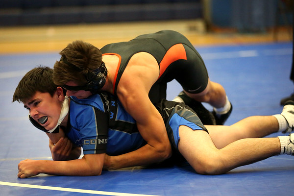 HADLEY GREEN/Staff photo<br /> Beverly's Jack Rivers wrestles Danvers' Connor McCarthy at the Danvers v. Beverly wrestling match at Danvers High School.<br /> <br /> 01/03/17