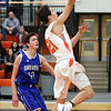HADLEY GREEN/Staff photo<br /> Beverly's Ryan Barror (21) shoots while Danvers' Justin DiTomaso (12) plays defense at the Beverly v. Danvers boys basketball game at Beverly High School.<br /> <br /> 01/05/17