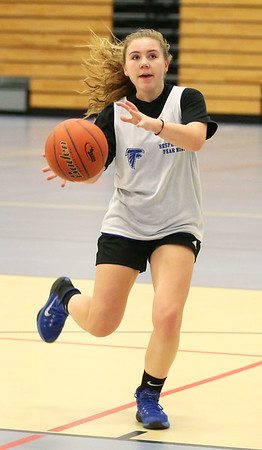 HADLEY GREEN/Staff photo<br /> Lydia Runnels dribbles at the Danvers girls basketball practice at Danvers High School.<br /> <br /> 02/01/18