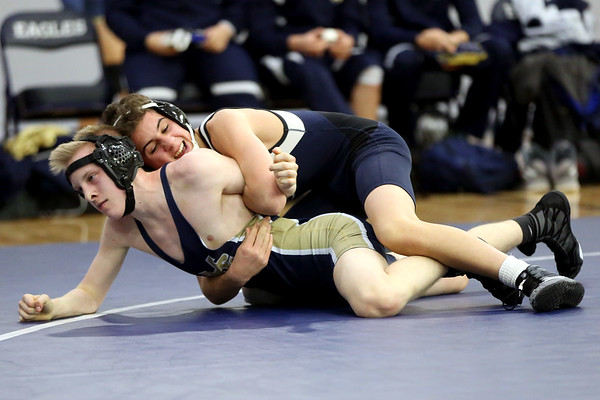 HADLEY GREEN/Staff photo<br /> St. John's Prep's Alec Runnals wrestles Malden Catholic's Logan Prousalis at the St. John's Prep v. Malden Catholic wrestling match at St. John's Prep.<br /> <br /> 1/10/17