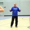 HADLEY GREEN/Staff photo<br /> Danvers girls basketball coach Pat Veilleux speaks to his team during practice.<br /> <br /> 02/01/18