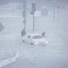 HADLEY GREEN/Staff photo<br /> People escape from a trapped car caught in flooding on Bridge Street in Salem during Thursday's blizzard.<br /> <br /> 01/03/17