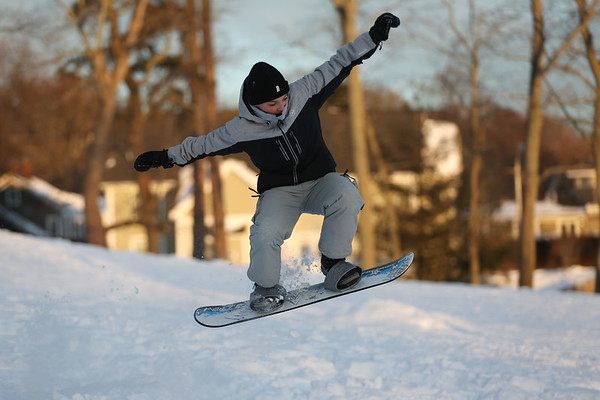 HADLEY GREEN/Staff photo<br /> James Silva catches some air while sledding down the hill at Lynch Park in Beverly on Saturday.<br /> <br /> 1/06/17
