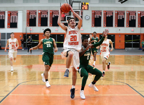 HADLEY GREEN/Staff photo<br /> Beverly's Luigi Derrane (20) shoots while Lynn Classical's Jaylen Johnson (0) plays defense at the Beverly v. Lynn Classical boys basketball game at Beverly High School.<br /> <br /> 1/09/17