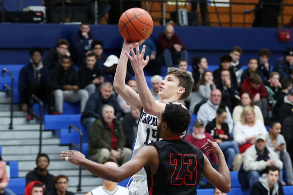 HADLEY GREEN/Staff photo<br /> Peabody's Joe O'Neill shoots while Salem's Jhoan Vago (23) plays defense at the Peabody v. Salem boys basketball game at Peabody High School.<br /> <br /> 01/30/18