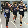 HADLEY GREEN/Staff photo<br /> Peabody's Joshua Atempka, left, and Marc Alperin, right, cross the finish line during the boys 1000 meter race at the Marblehead v. Peabody track meet at Marblehead High School.<br /> <br /> 02/01/18