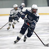 HADLEY GREEN/Staff photo<br /> Hamilton-Wenham's Aidan Doly (14) lines up his shot at the Essex Tech v. Hamilton-Wenham boys hockey game at the Essex Sports Center. <br /> <br /> 01/31/18
