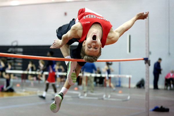 HADLEY GREEN/Staff photo<br /> Jack Barker of Marblehead clears the pole in high jump at the Marblehead v. Peabody track meet at Marblehead High School.<br /> <br /> 02/01/18