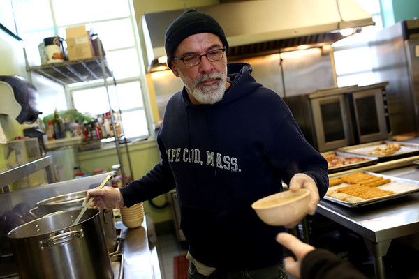HADLEY GREEN/Staff photo<br /> Raymond Sweeney serves hot soup to people at Lifebridge homeless shelter in Salem during Thursday's blizzard.<br /> <br /> 01/04/17