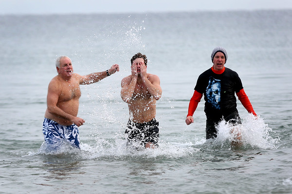 HADLEY GREEN/Staff photo<br /> People dive into the icy water at the annual Plunge for Pete at Good Harbor Beach in Gloucester.<br /> <br /> 12/30/17