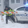 HADLEY GREEN/Staff photo<br /> A policeman places barricades at the intersection of Federal Street and Park Street in Beverly because of flooding during Thursday's blizzard.<br /> <br /> 01/04/17