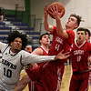 HADLEY GREEN/Staff photo<br /> Essex Tech's Anderson Villa (10) and Saugus' Mason Nickolas (44) vie for the rebound at the Essex Tech v. Saugus boys basketball game at Essex Tech. <br /> <br /> 01/16/18