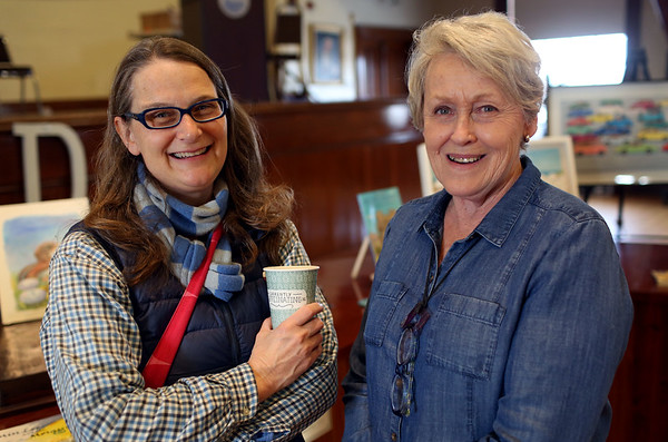 HADLEY GREEN/Staff photo<br /> From left, Alexandra Rhinelander and Patty Rhinelander, both of Gloucester, attend the Cape Ann Reads community fair at Gloucester City Hall.<br /> <br /> 01/27/18