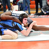 HADLEY GREEN/Staff photo<br /> Marblehead's Armani Dotson and Danvers' Robert Murphy wrestle at the annual CAL/NEC Open at Beverly High School.<br /> <br /> 01/27/18