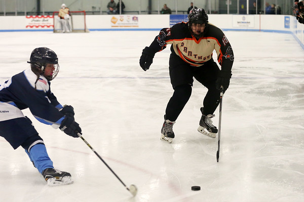 HADLEY GREEN/Staff photo<br /> Beverly's Megan Caley (18) moves towards the puck at the Beverly v. Peabody girls hockey game at Endicott College.<br /> <br /> 1/06/17