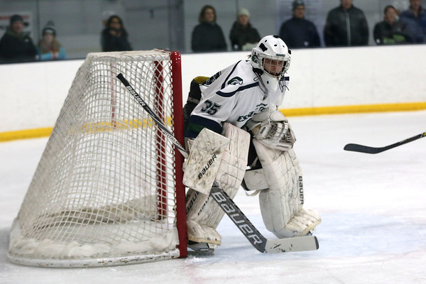 HADLEY GREEN/Staff photo<br /> Essex Tech goalie Shane Anlin (35) guards the net at the Essex Tech v. Hamilton-Wenham boys hockey game at the Essex Sports Center. <br /> <br /> 01/31/18