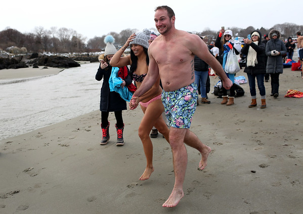 HADLEY GREEN/Staff photo<br /> People run into the ocean at the annual Plunge for Pete at Good Harbor Beach in Gloucester.<br /> <br /> 12/30/17