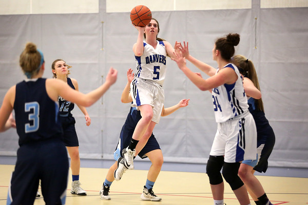 HADLEY GREEN/Staff photo<br /> Danvers' Siobhan Moriarty (5) jumps to make a shot at the Danvers v. Peabody girls basketball game at Danvers High School. <br /> <br /> 01/03/17