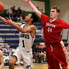 HADLEY GREEN/Staff photo<br /> Essex Tech's Jose Taveras (1) shoots while Saugus' Mason Nickolas (44) plays defense at the Essex Tech v. Saugus boys basketball game at Essex Tech. <br /> <br /> 01/16/18