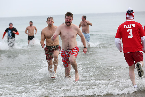 HADLEY GREEN/Staff photo<br /> Dozens of people donned swimsuits and braved the cold at the annual Plunge for Pete at Good Harbor Beach in Gloucester.<br /> <br /> 12/30/17