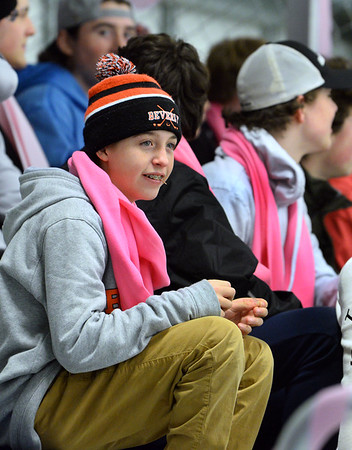 CARL RUSSO/Staff photo. Beverly high freshman, Matthew Capachietti and his friends show their support by wearing pink scarfs during the game. <br /> <br /> The annual Colleen Ritzer memorial hockey game between Andover high and Beverly/Danvers was played on January 9, Wednesday night at the Raymond Bourque arena at Endicott College. The game benefits the Colleen Ritzer Memorial Scholarship Fund. <br /> <br /> Colleen Ritzer of Andover, a Danvers high school teacher was murdered in 2013 by her student. 1/9/2019