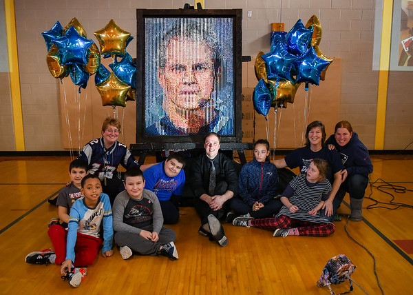 Artist in residence Rob Surette works with Brown School students on large Lego mosaic mural
