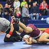 JAIME CAMPOS/Staff photo<br /> <br /> Masconomet's Jack Darling pins Tayo Onifade of Josiah Quincy in the 132lbs weight class during a wrestling meet at St. John's Prep in Danvers<br /> <br /> 1/21/2019