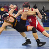 JAIME CAMPOS/Staff photo<br /> <br /> Liam McAveney of Masconomet takes down Josiah Quincy's Ricky Sun in the 126lbs weight class during a wrestling meet at St. John's Prep in Danvers<br /> <br /> 1/21/2019