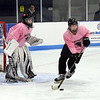 CARL RUSSO/Staff photo. Beverly/Danvers sophomore goalie, Julia Otterbein and senior captain, Shelby Johnson are ready for action. <br /> <br /> The annual Colleen Ritzer memorial hockey game between Andover high and Beverly/Danvers was played on January 9, Wednesday night at the Raymond Bourque arena at Endicott College. The game benefits the Colleen Ritzer Memorial Scholarship Fund. <br /> <br /> Colleen Ritzer of Andover, a Danvers high school teacher was murdered in 2013 by her student. 1/9/2019
