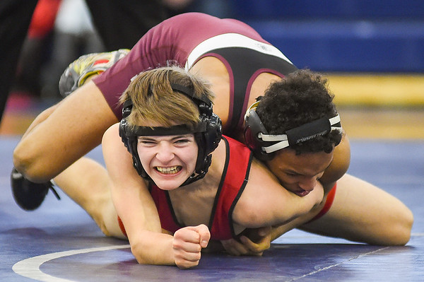 JAIME CAMPOS/Staff photo<br /> <br /> Nick Mandracchia of Masconomet attempts to break loose from Josiah Quincy's Nicholas Centeio in the 113lbs weight class during a wrestling meet at St. John's Prep in Danvers<br /> <br /> 1/21/2019