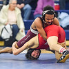 JAIME CAMPOS/Staff photo<br /> <br /> Josiah Quincy's Nicholas Centeio maintains his ground work against Nick Mandracchia of Masconomet in the 113lbs weight class during a wrestling meet at St. John's Prep in Danvers<br /> <br /> 1/21/2019