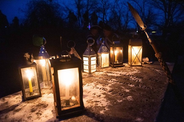 Lantern's glow on the graveside of General Glover. Glover's Marblehead Regiment joined at the Old Town House and marched to Burial Hill in honor of the contributions and sacrifices of Marblehead residents during the Revolutionary War. RYAN MCBRIDE/Staff photo 2/1/20