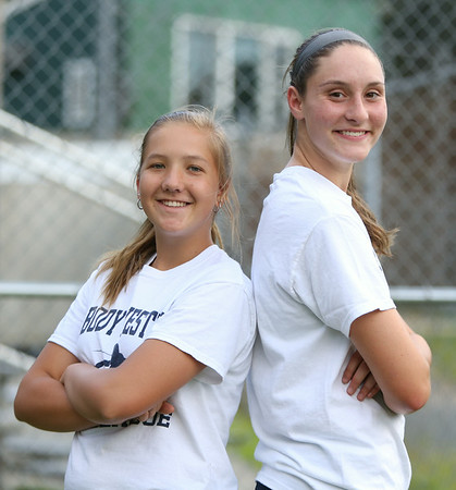 Peabody West aces Mallory LeBlanc, left, and Mikayla Porcaro. The Peabody West Softball All-Star team will look to make some noise in the upcoming Regional action in Orange, CT. DAVID LE/Staff photo. 7/28/14.