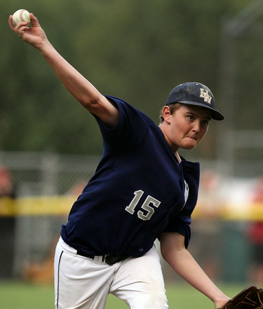 Hamilton-Wenham starting pitcher Aidan Cann fires a pitch against Barnstable during the first inning of play. The Generals lost to Barnstable 12-1 in a shortened 4 inning contest on Friday evening at Harry Ball Field in Beverly. DAVID LE/Staff photo. 7/25/14.