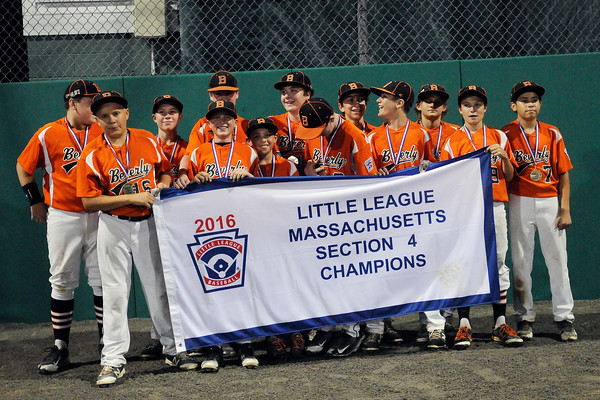 TIM JEAN/Staff photo Beverly's players pose for more photos after winning the Section 4 Little League all-star championship game.  Beverly defeated Andover 9-4.  7/23/16