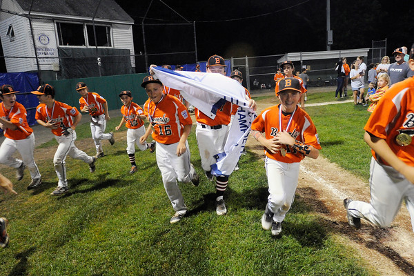 TIM JEAN/Staff photo Beverly's players run around the field as they celebrate winning the Section 4 Little League all-star championship game.  Beverly defeated Andover 9-4.  7/23/16