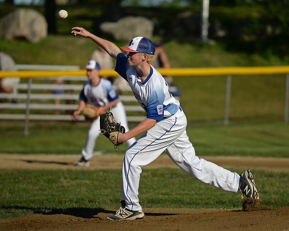 RYAN HUTTON/ Staff photo<br /> Danvers' John Curran fires one in from the mound during the top of the first inning of Wednesday's game against Gloucester at Boudreau Field in Gloucester.